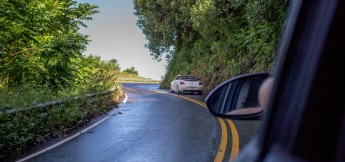 Driving around a curve road to Hana Maui